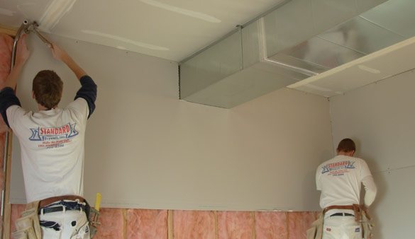 Photo of Standard Drywall employees doing a comemrcial drywall installation